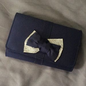 Navy hand bag with attachable chain strap